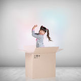 Beautiful little girl inside a cardboard box Stock Photo