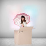Beautiful little girl inside a cardboard box Royalty Free Stock Photo