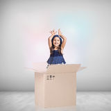 Beautiful little girl inside a cardboard box Stock Image