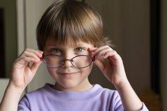 Beautiful little girl with intelligent eyeglasses Royalty Free Stock Photo