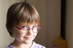 Beautiful little girl with intelligent eyeglasses Stock Photo