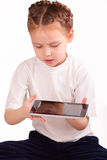 Beautiful little girl with ipad Royalty Free Stock Photography