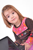 Beautiful little girl with laptop Royalty Free Stock Images