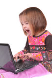 Beautiful little girl with laptop Stock Photography