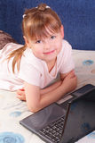 Beautiful little girl with laptop Royalty Free Stock Photo