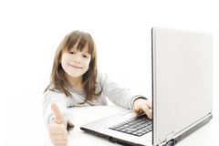 Beautiful little girl with laptop computer. Stock Photo