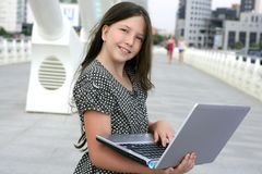 Beautiful little girl with laptop computer Stock Images