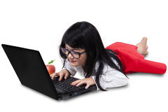 Beautiful little girl with laptop in studio Stock Image
