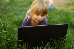 Beautiful little girl with a laptop Stock Photography
