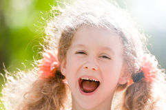 Beautiful little girl laughing Stock Images