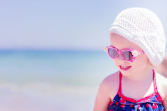 Beautiful little girl laughs on the background of the sea. Stock Images