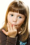 Beautiful little girl licking fingers Royalty Free Stock Photography