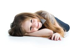 Beautiful little girl lie Stock Images