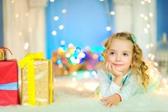 Girl dreams of gifts Royalty Free Stock Photography