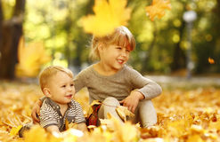 Beautiful little girl with a little brother in the autumn park p Stock Photo