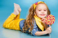Beautiful little girl with lollipop Stock Photography