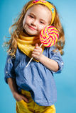 Beautiful little girl with lollipop Royalty Free Stock Photo