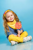 Beautiful little girl with lollipop Royalty Free Stock Photos