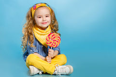 Beautiful little girl with lollipop Royalty Free Stock Image