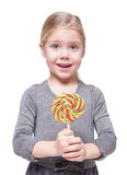 Beautiful little girl with lollipop isolated Stock Photo