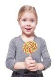 Beautiful little girl with lollipop isolated Stock Photo