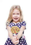 Beautiful little girl with lollipop isolated Stock Photos