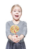 Beautiful little girl with lollipop isolated Royalty Free Stock Image
