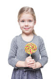Beautiful little girl with lollipop isolated Royalty Free Stock Photography