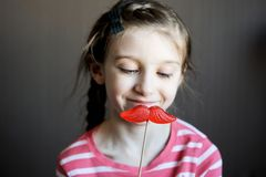 Beautiful little girl with lollipop Stock Photo