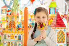 Beautiful little girl  with lollipop smiling at camera Royalty Free Stock Photography