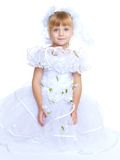 Beautiful little girl in a long white princess Stock Image