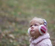 Beautiful little girl looking aside royalty free stock photo