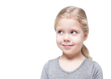 Beautiful little girl looking on something isolated Stock Image