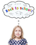 Beautiful little girl looking up on Back to school isolated. Over white Royalty Free Stock Photography