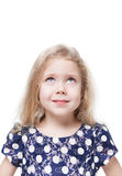 Beautiful little girl looking up on something isolated Stock Photos
