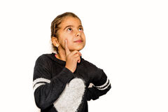 Beautiful little girl looking up and thinking.  Royalty Free Stock Photo
