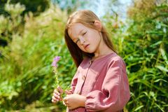 Beautiful little girl looks away dreaming royalty free stock image