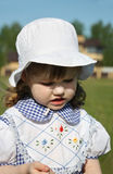 Beautiful little girl looks down outdoor Royalty Free Stock Image