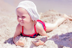 Beautiful little girl lying on the beach Royalty Free Stock Images