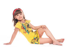 Beautiful little girl lying on floor Stock Photo
