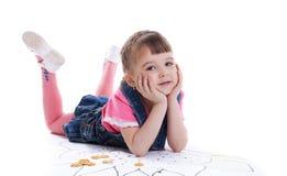 Beautiful little girl lying on floor Stock Image