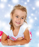Beautiful little girl lying on the floor, and what you're dreami Royalty Free Stock Image