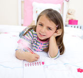 Beautiful little girl lying on her bed Royalty Free Stock Image
