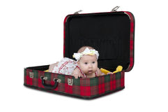 Beautiful little girl lying in a suitcase Royalty Free Stock Image