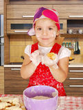 Beautiful little girl make rolls Royalty Free Stock Images
