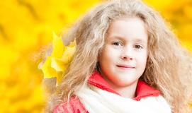 Beautiful little girl with maple leaf. Stock Image
