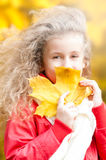 Beautiful little girl with maple leaf. Stock Photography