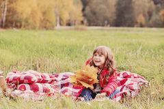 Beautiful little girl with maple leaves Stock Image