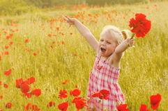 Beautiful little girl on a meadow royalty free stock images