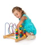 Beautiful little girl in a Montessori class royalty free stock photo